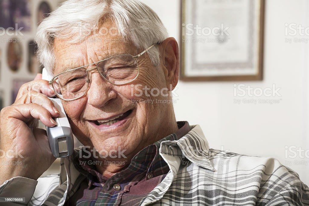 happy senior man talking on telephone stock photo