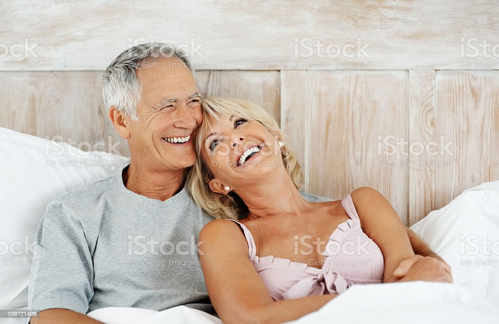 Happy senior man with his wife inbed royalty-free stock photo