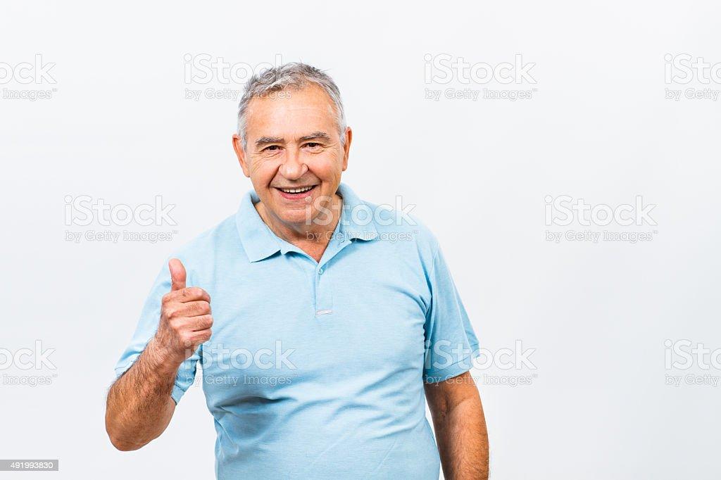 Happy senior man with thumb up stock photo