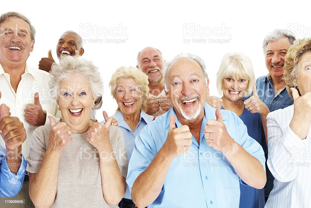 Happy senior men and women showing thumbs up stock photo