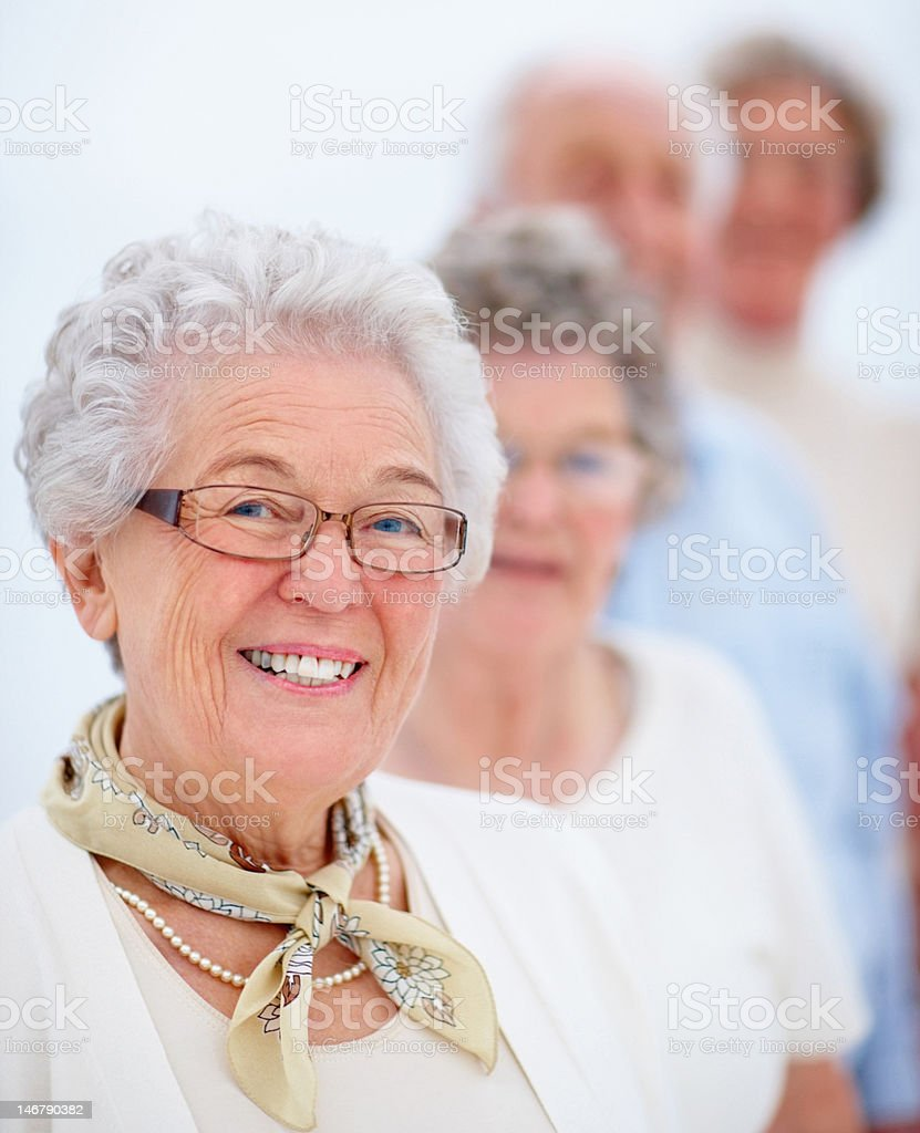 Happy senior men and women standing in a line royalty-free stock photo