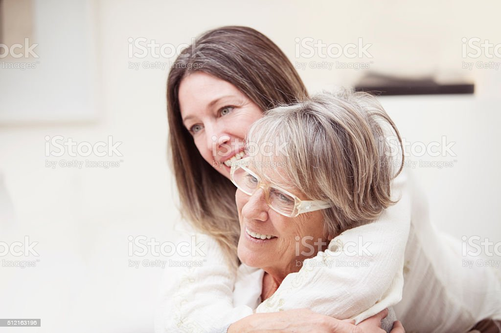 Happy senior mother and daughter portrait stock photo