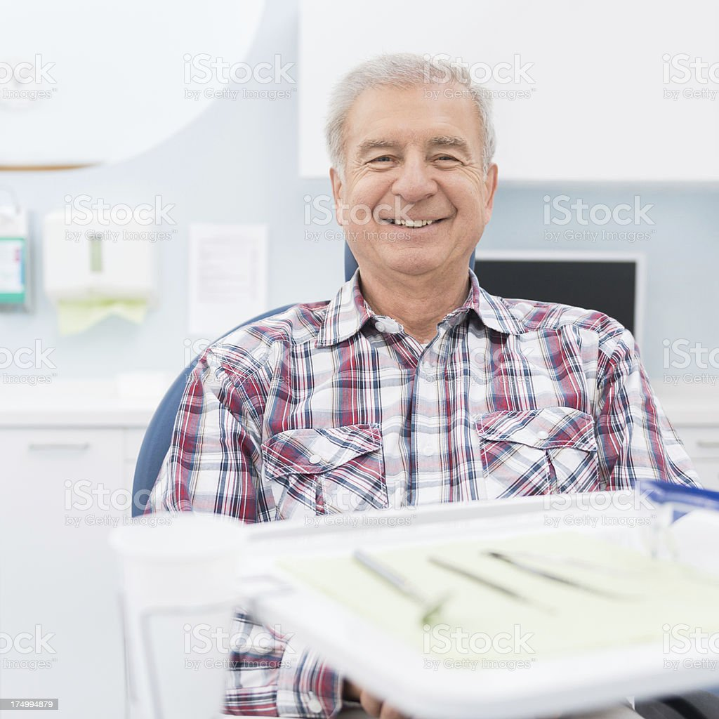 Happy Senior Patient at Dentist royalty-free stock photo