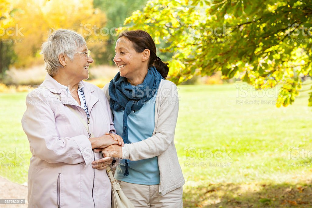 Senior woman and caregiver stock photo