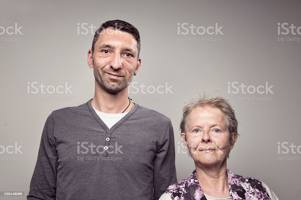 Happy senior woman and midadult man stock photo