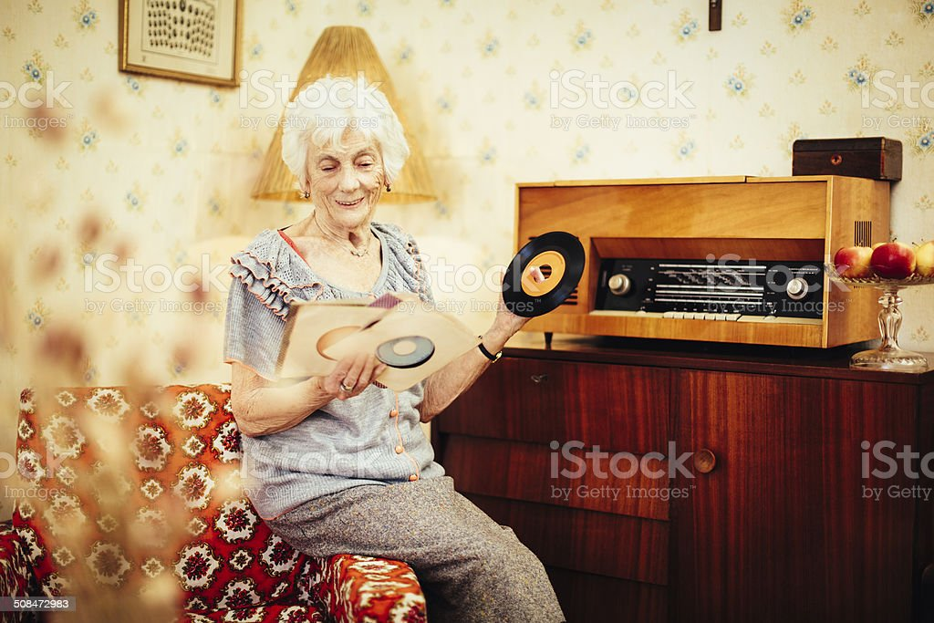 Happy senior woman at home stock photo