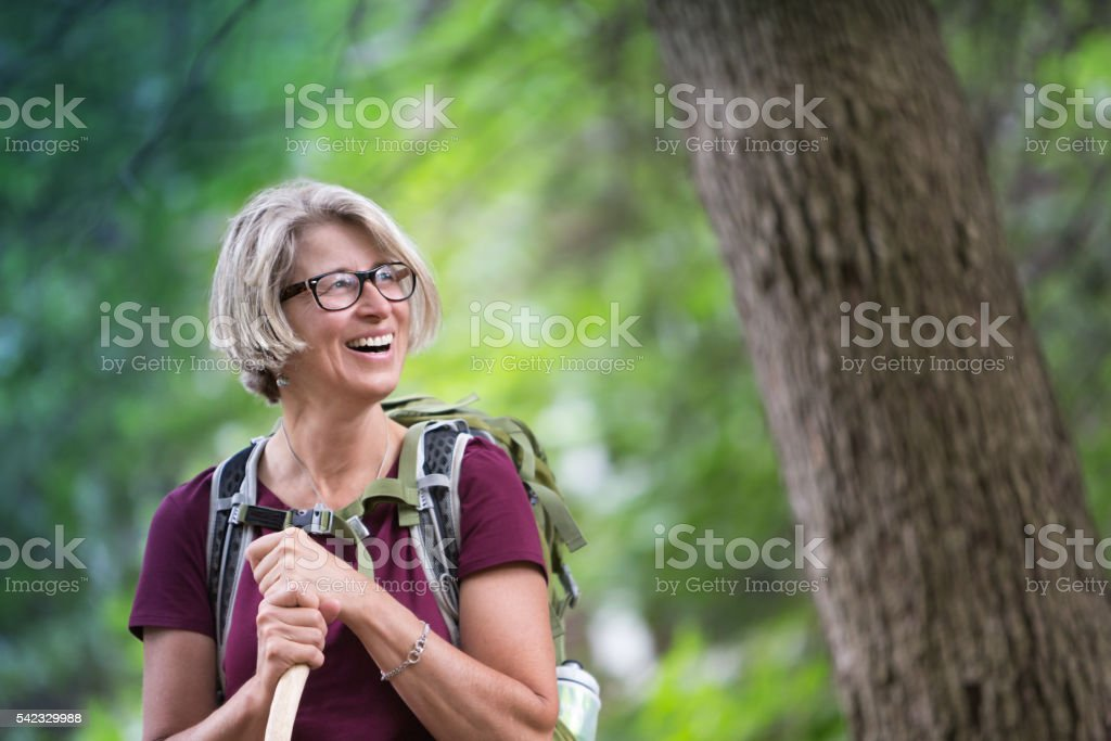 Happy Senior Woman Backpacking stock photo