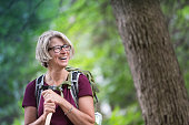 Happy Senior Woman Backpacking