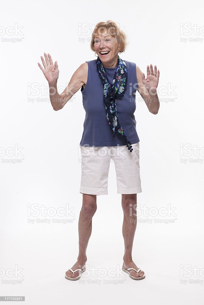 Happy senior woman dancing stock photo