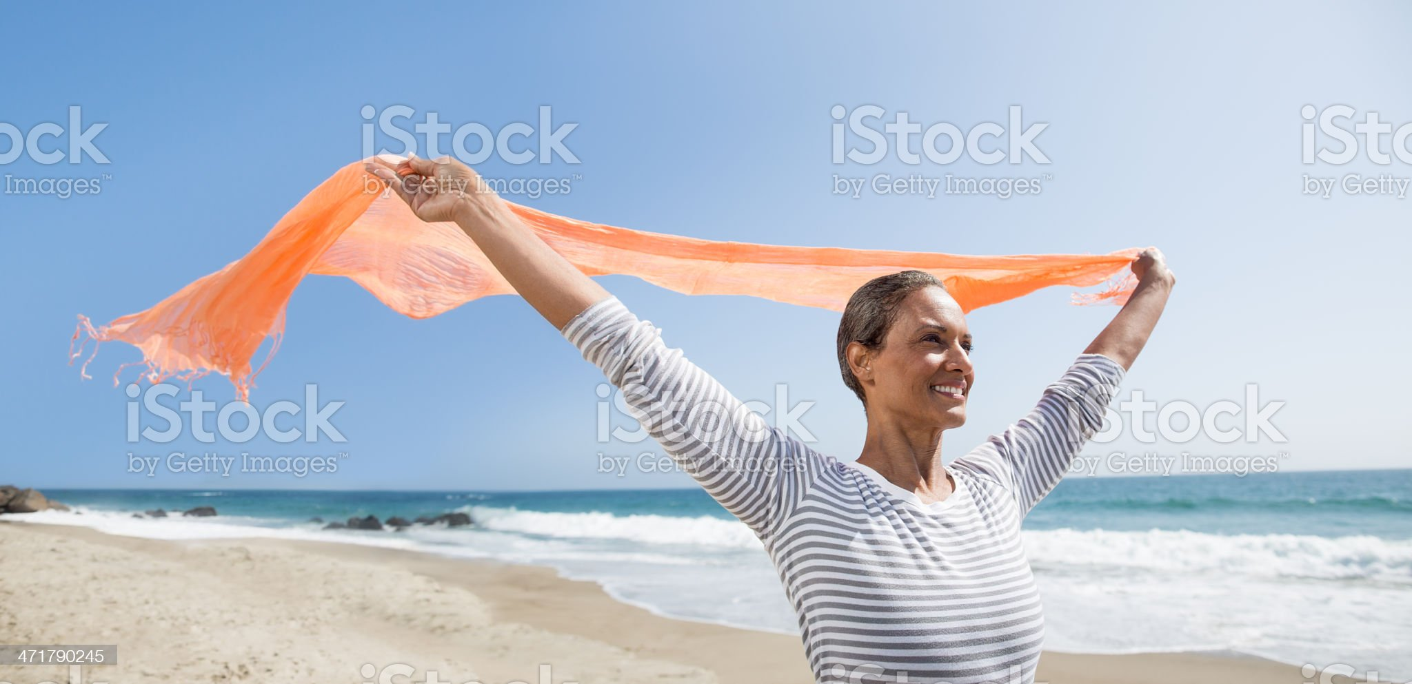 Happy senior woman enjoying the wind royalty-free stock photo