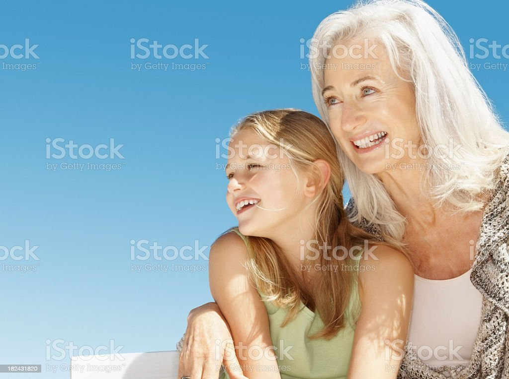 Happy senior woman hugging granddaughter royalty-free stock photo
