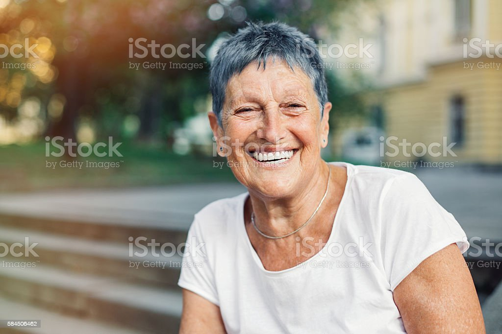 Happy senior woman in summer stock photo