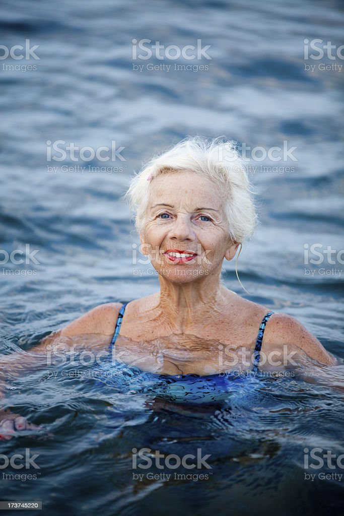Happy Senior Woman In The Sea royalty-free stock photo
