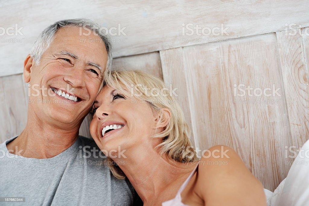 Happy senior woman resting on mature man's shoulder royalty-free stock photo