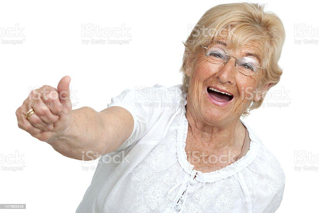 Heureuse femme senior montrant positive. photo libre de droits