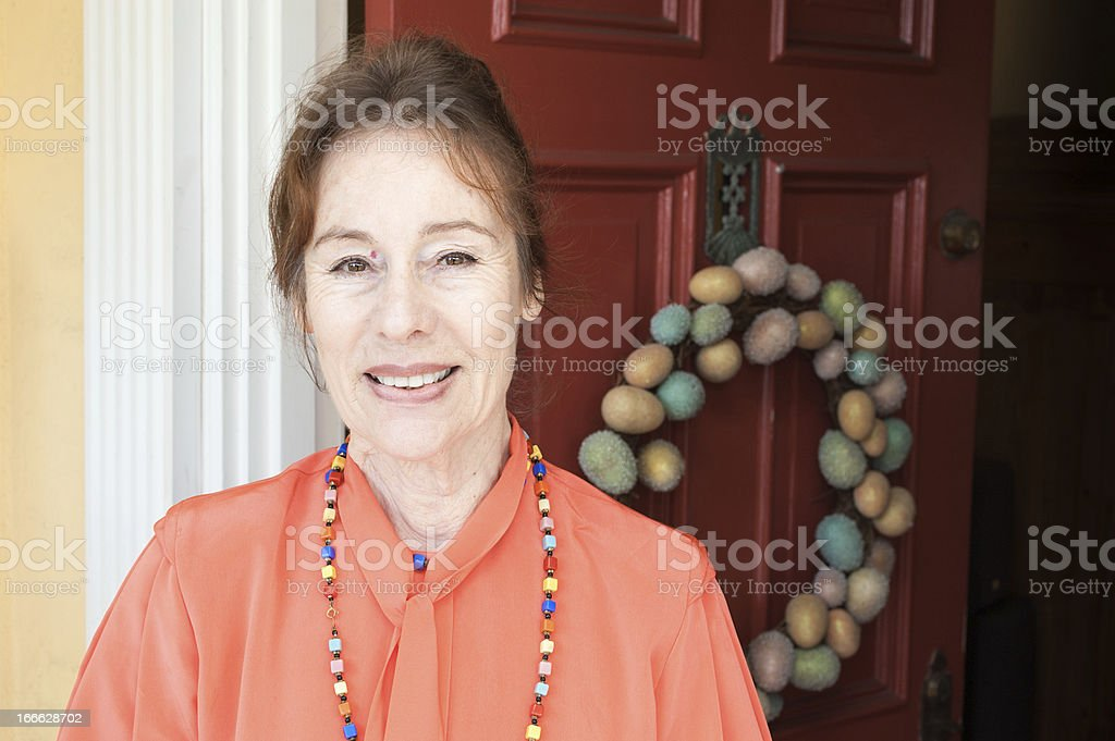 Happy Senior Woman stands in doorway royalty-free stock photo