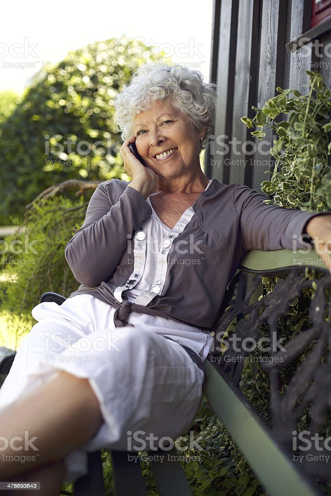 Happy senior woman talking on mobile phone royalty-free stock photo