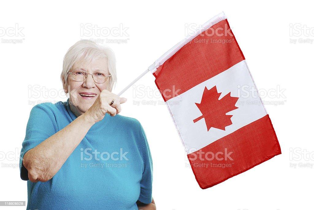 Happy Senior Woman Waving Canada Flag royalty-free stock photo