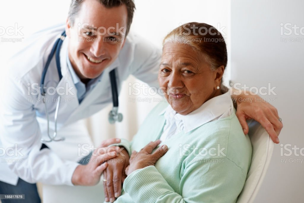 Happy senior woman with a doctor royalty-free stock photo