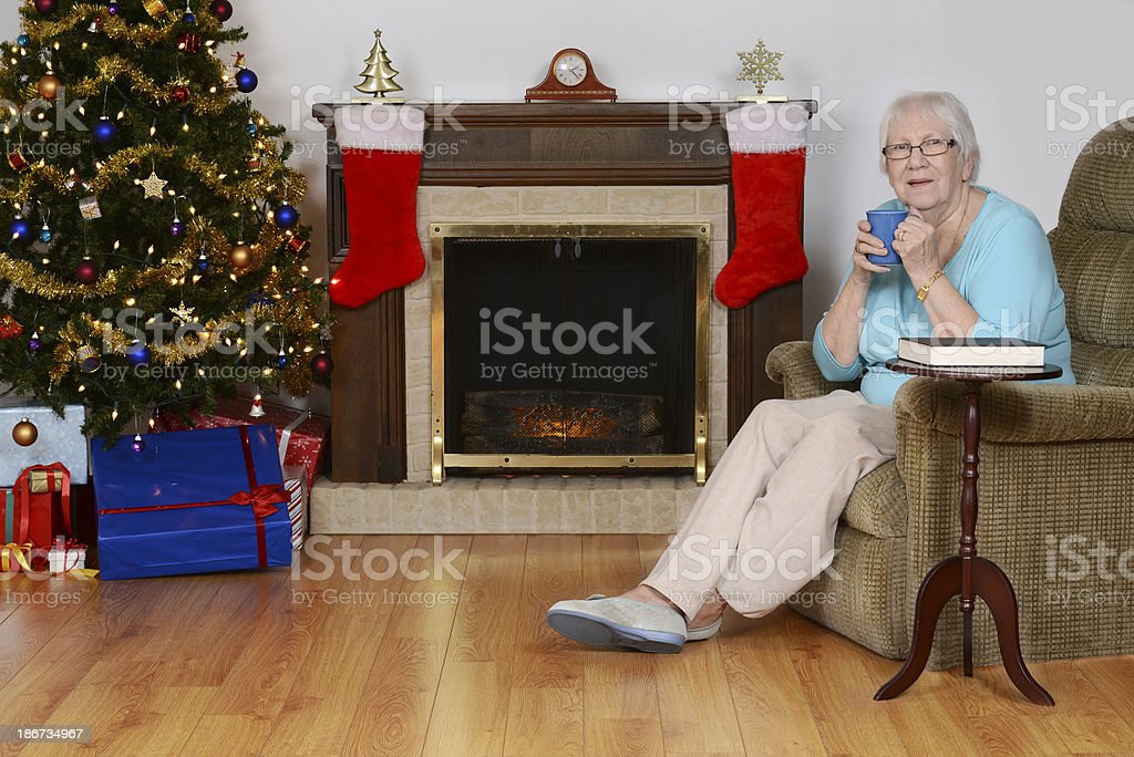 happy senior woman with coffee at christmas stock photo