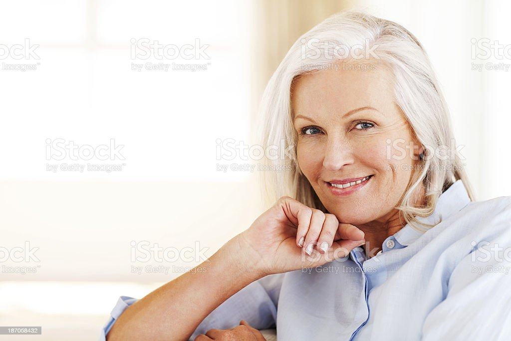 Happy Senior Woman With Hand On Chin stock photo