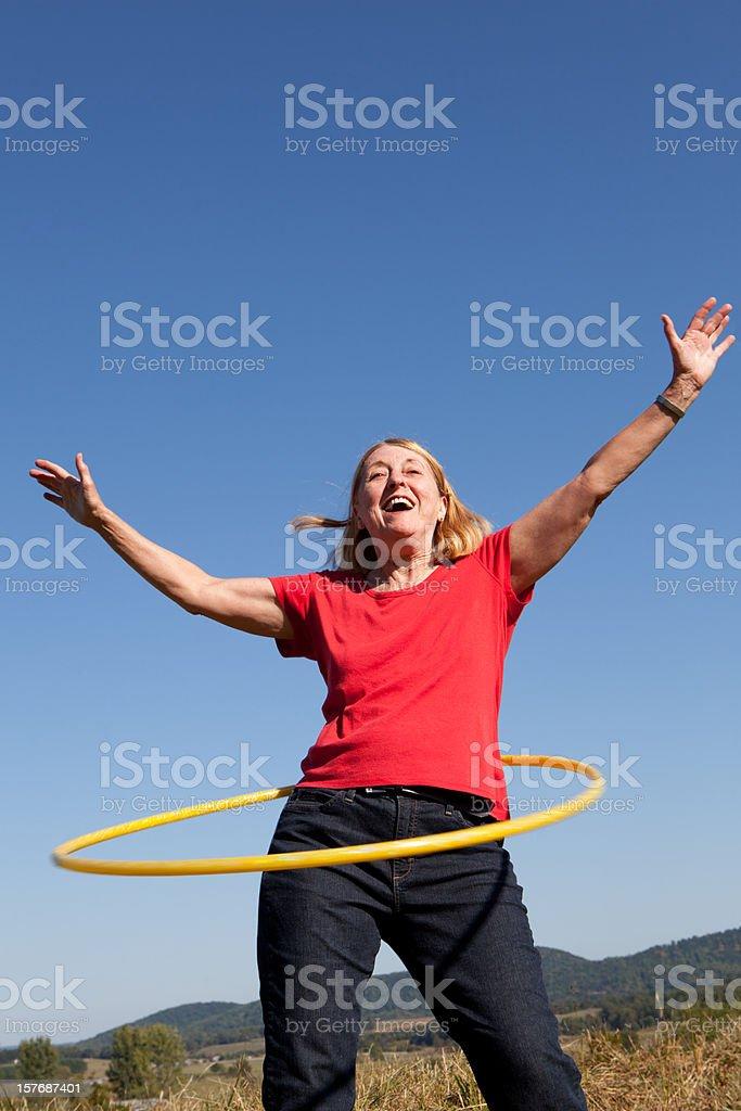 Happy Senior Woman with Hoop. Exercise. stock photo
