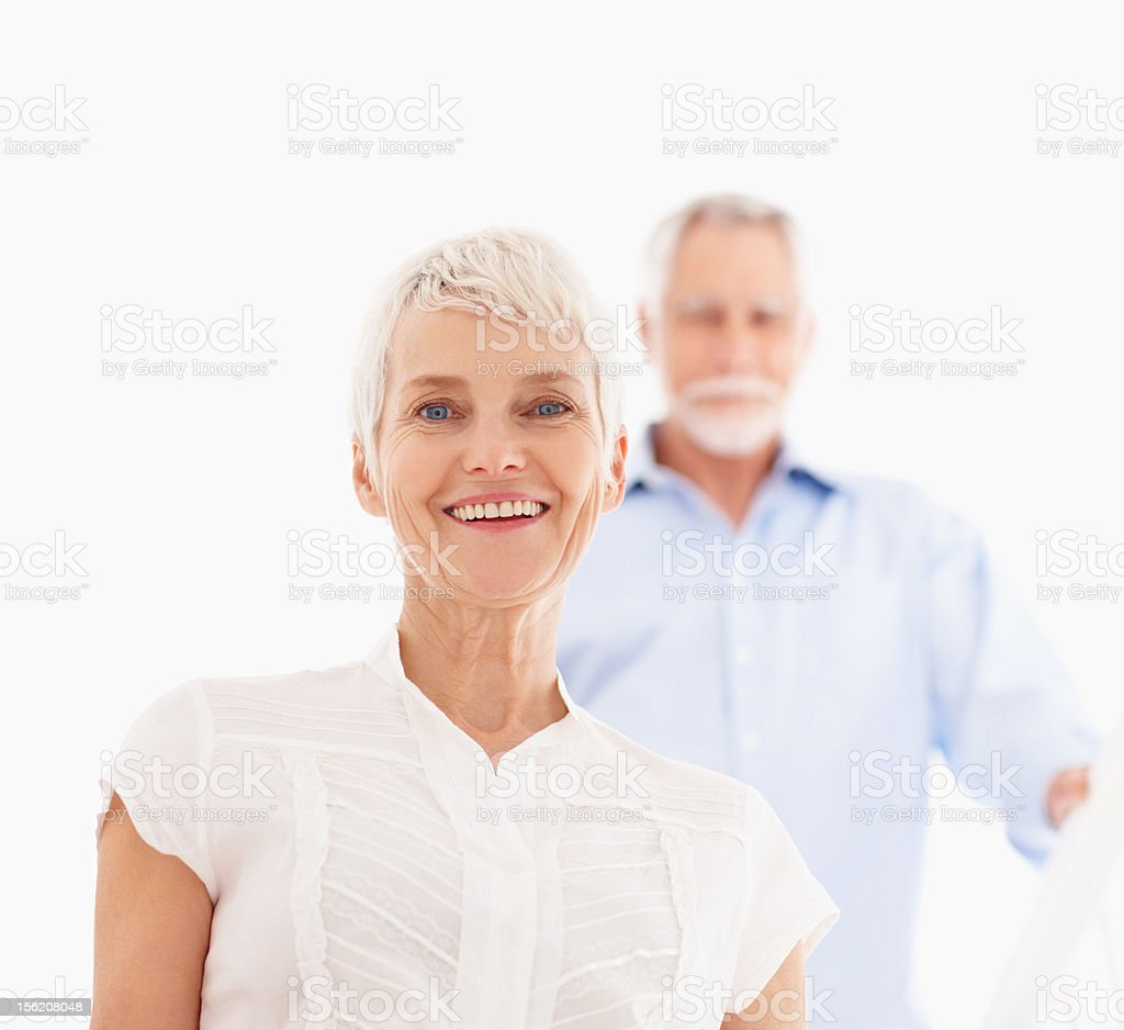 Happy senior woman with man in the background royalty-free stock photo