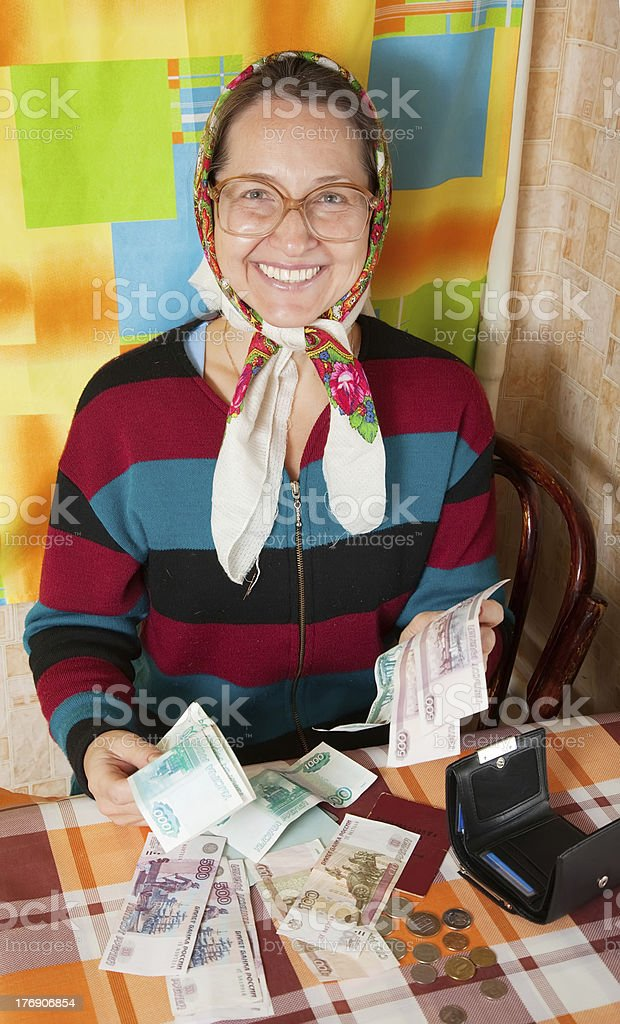 happy senior woman with money stock photo