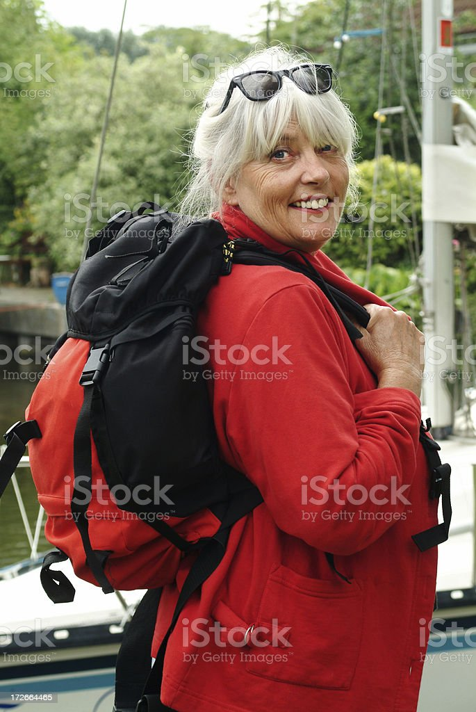 Happy senior woman with Rucksack royalty-free stock photo