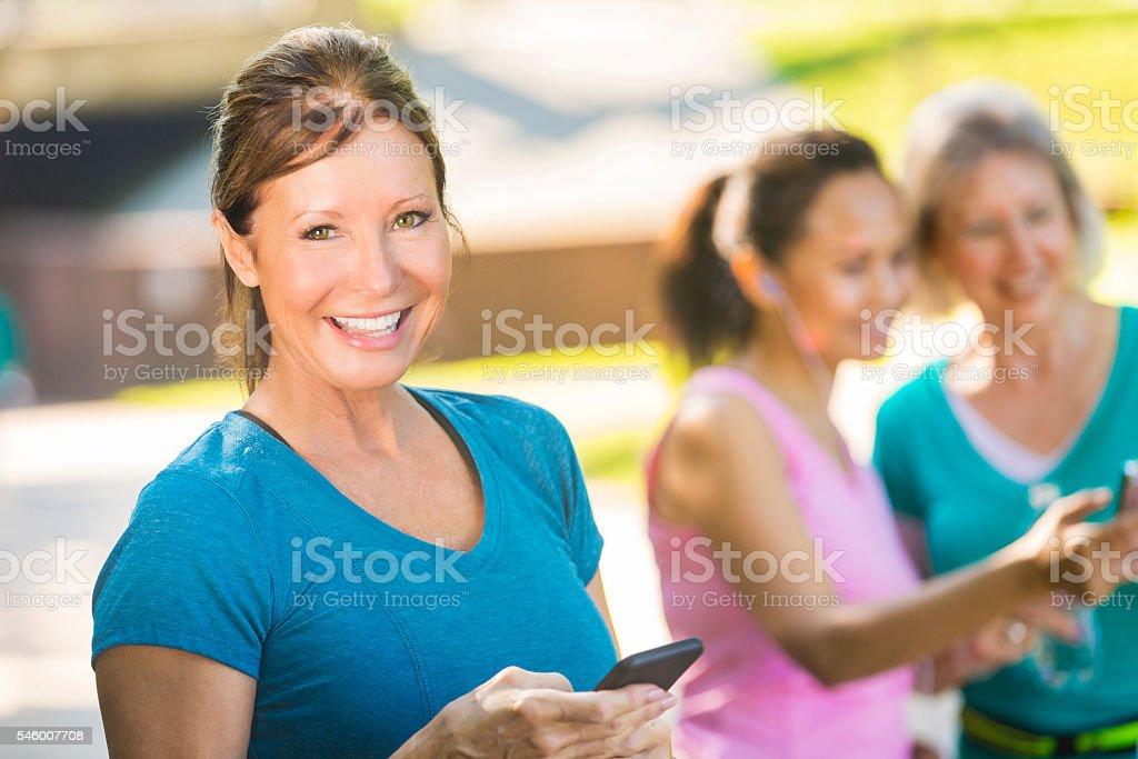Happy senior woman with smart phone stock photo
