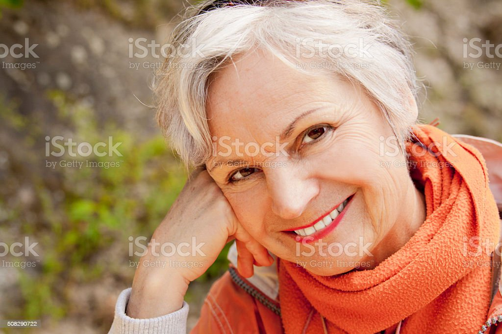 happy senior women smiling outdoors stock photo