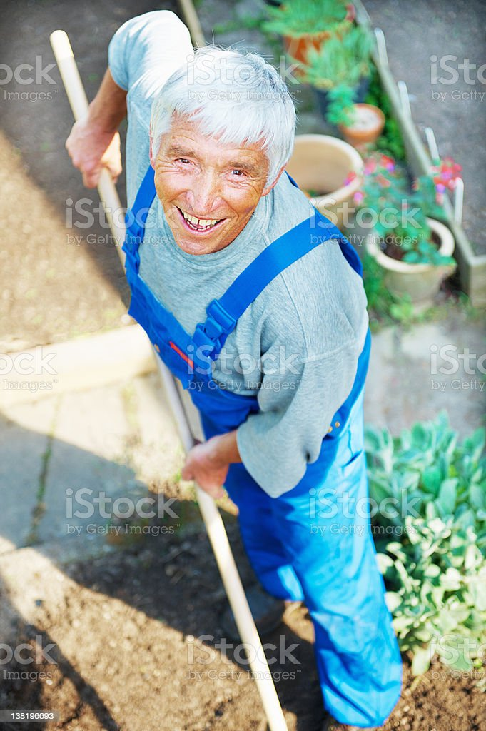 Happy senior working in his garden royalty-free stock photo