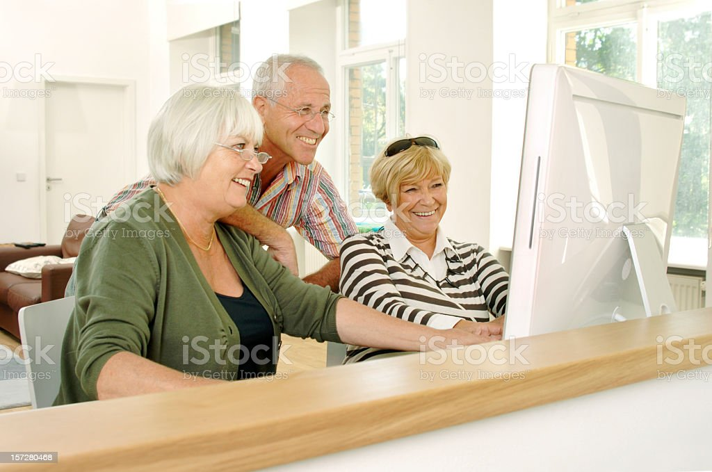 Happy Seniors at the Computer royalty-free stock photo