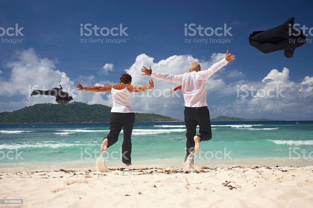 happy seniors running into the water royalty-free stock photo