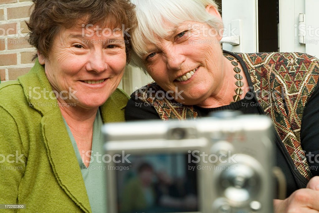 Happy Seniors taking picture of themselves royalty-free stock photo