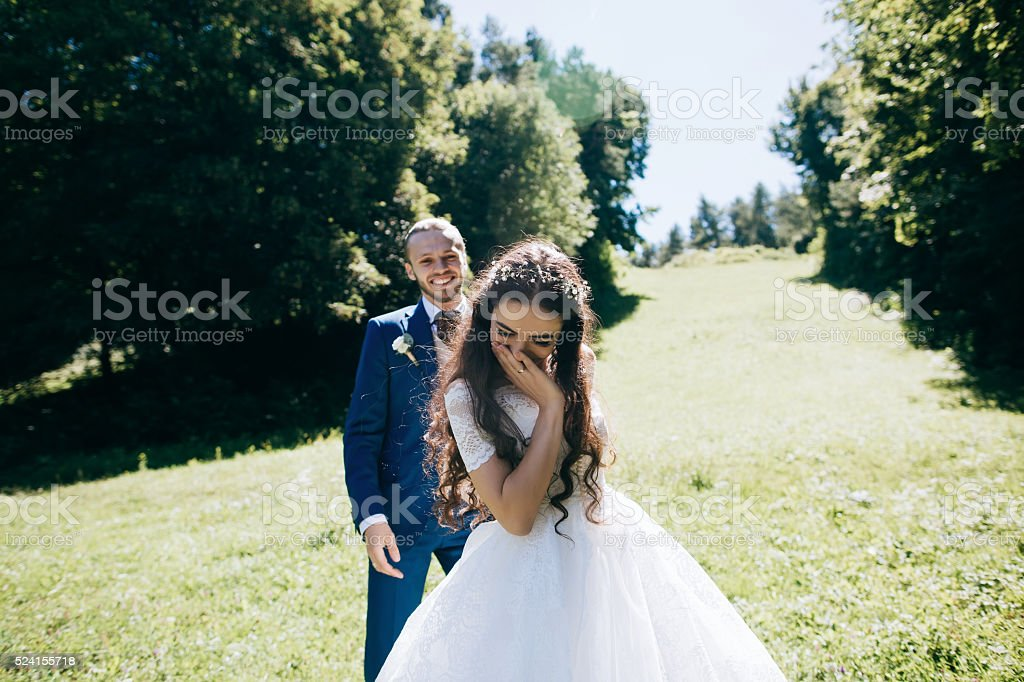 Happy sensual Bride and groom at wedding Day stock photo