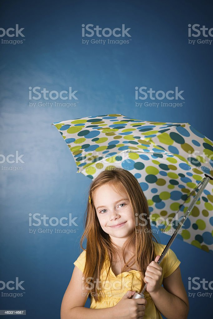 Happy Seven Year Old Red-Haired Girl Holding Umbrella royalty-free stock photo