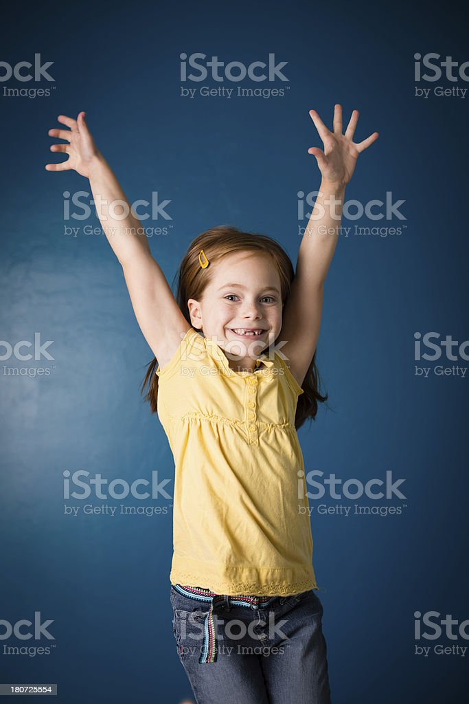 Happy, Seven Year Old Red-Headed Girl With Hands Raised royalty-free stock photo