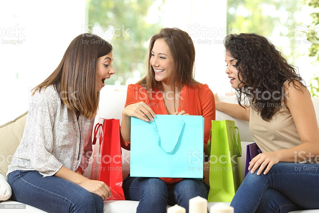 Happy shoppers with shopping bags stock photo