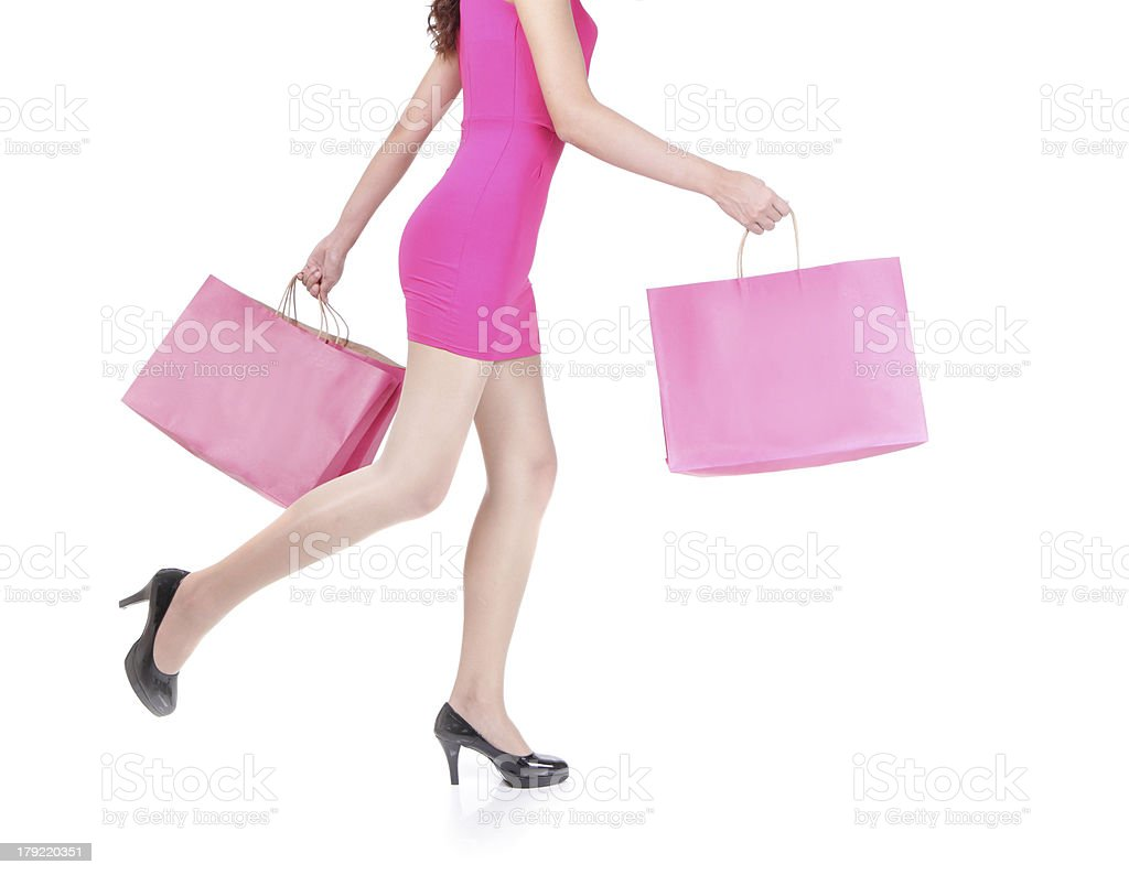 happy shopping young woman running royalty-free stock photo