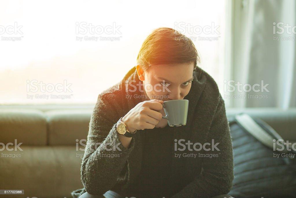 Happy short hair girl enjoying drink coffee stock photo