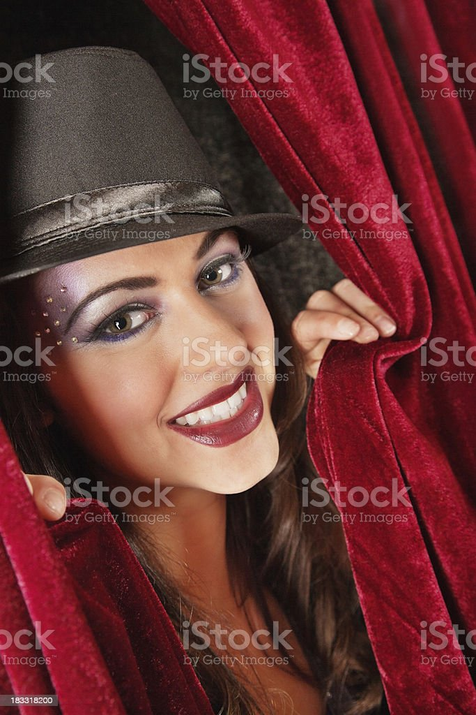 Happy Show Girl Holding Red Curtains Open royalty-free stock photo