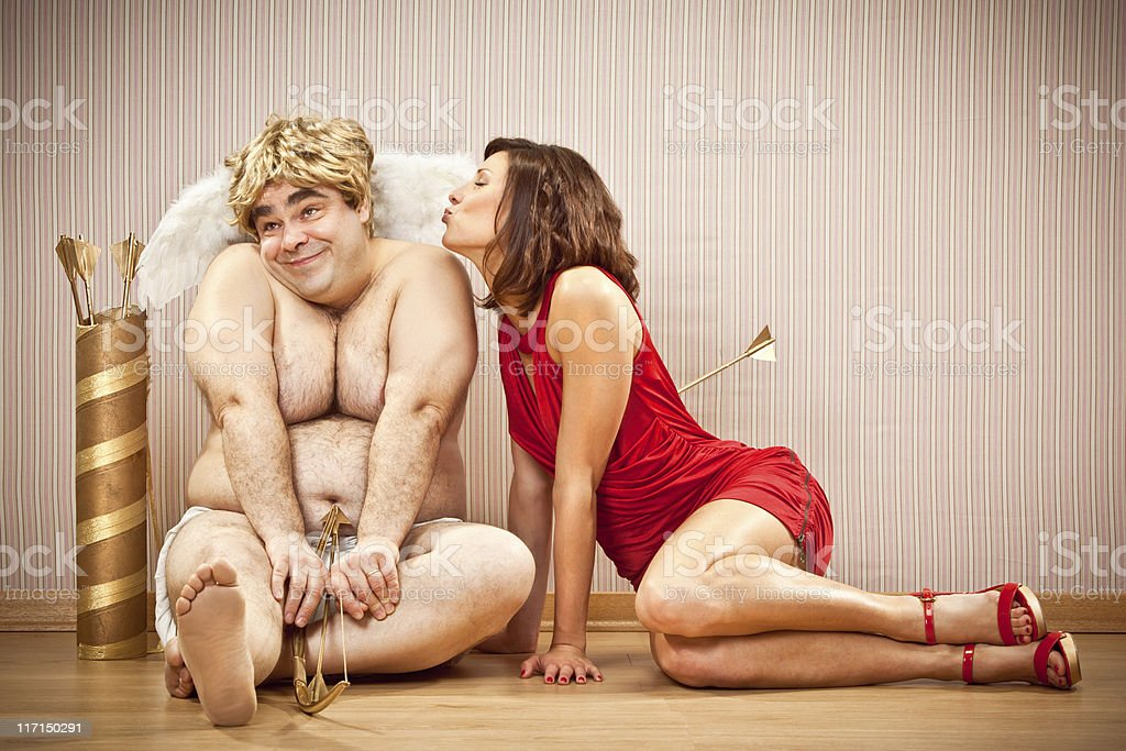 happy shy cupid kissed by beautiful girl royalty-free stock photo