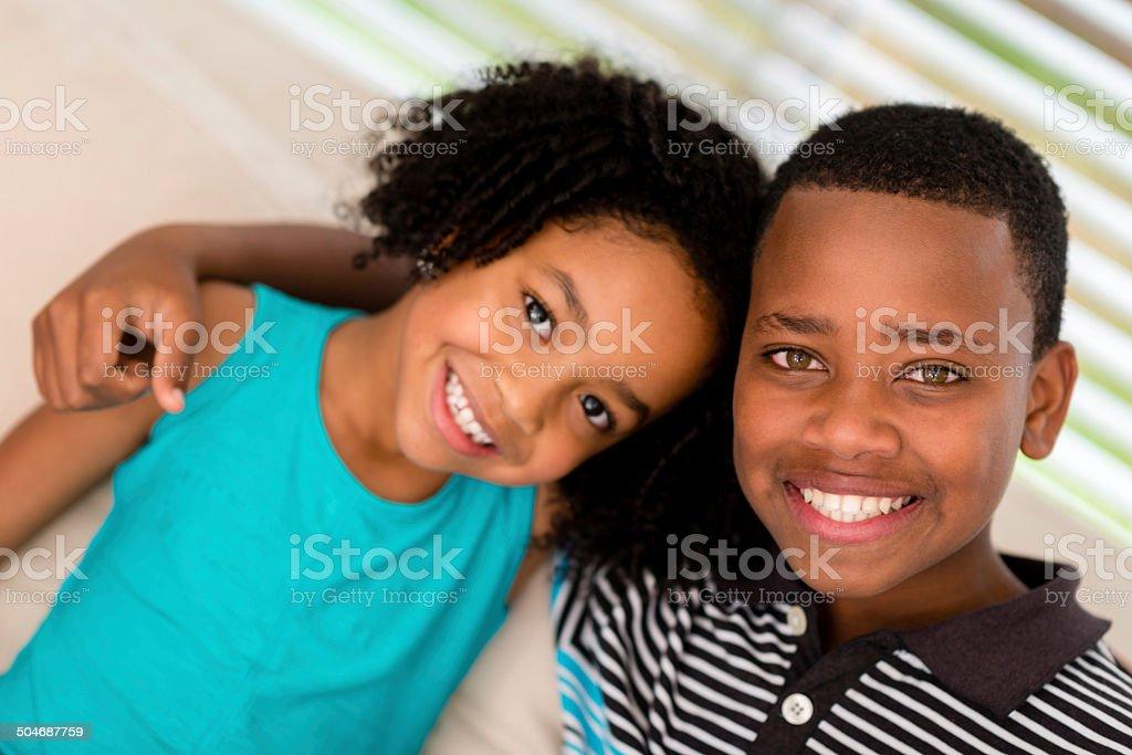 Happy siblings at home stock photo