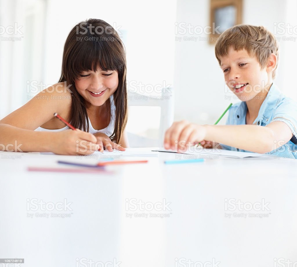 Happy siblings drawing at home with copyspace royalty-free stock photo