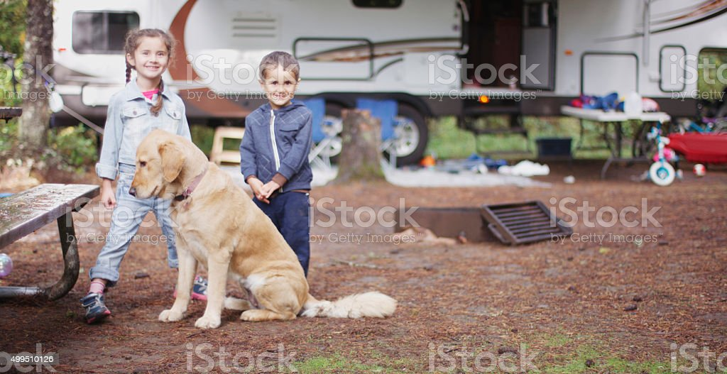 Happy Siblings Going Camping stock photo