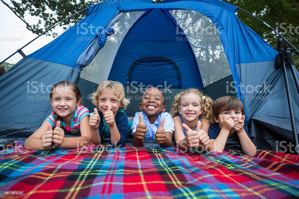 Happy siblings on a camping trip stock photo