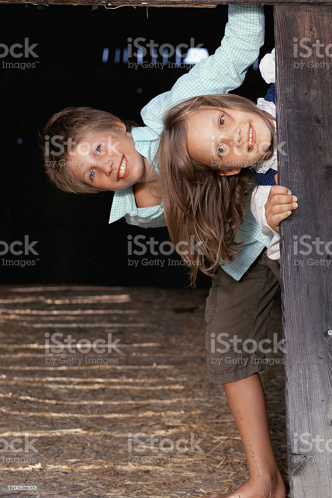 happy siblings on farm royalty-free stock photo