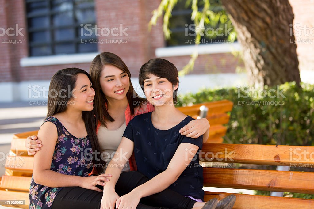 Happy sisters together stock photo