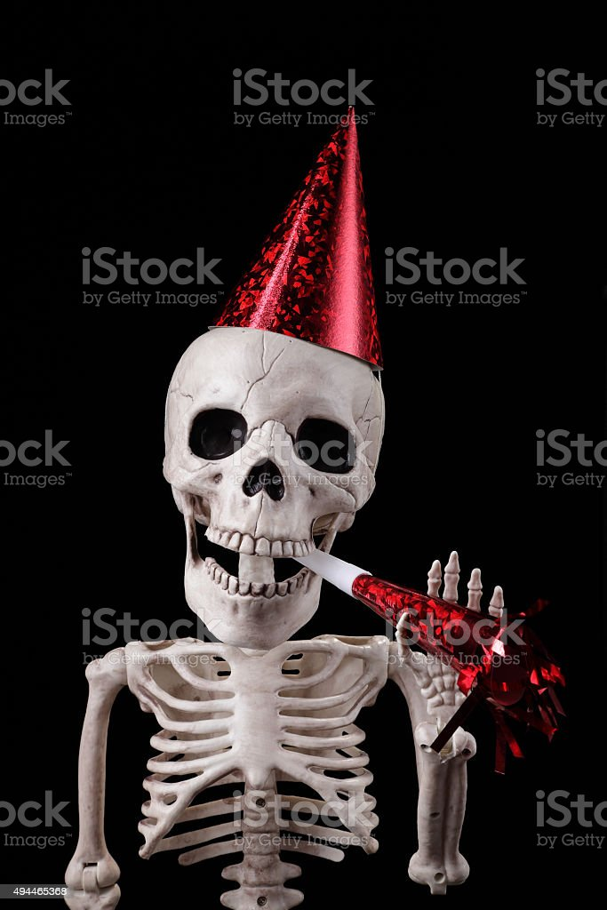 Happy skeleton at a party stock photo